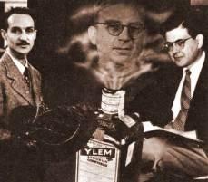 Herman Gamow y Alpher en un fotomontaje de 1949 realizado por el propio Alpher. Se muestra a Gamow saliendo de la botella YLEM (sopa inicial de partículas)
